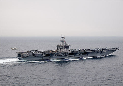 US forces administered Muslim religious rites for Osama bin Laden aboard the aircraft carrier USS Carl Vinson on Monday in the Arabian Sea after the raid Sunday that killed the Al Qaeda leader. A US spokesman said bin Laden's body was washed, wrapped in a white sheet, placed in a weighted bag and eased into the sea after a 50-minute ceremony.