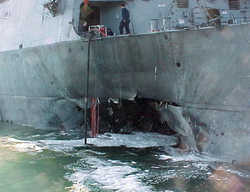 This photo shows the port side of the guided missile destroyer USS Cole, damaged after a suspected terrorist bomb exploded during a refueling operation in the port of Aden in Yemen on Oct. 12, 2000. Al Qaeda later claimed responsibility for the attack, which killed 17 US sailors and injured 39 others.