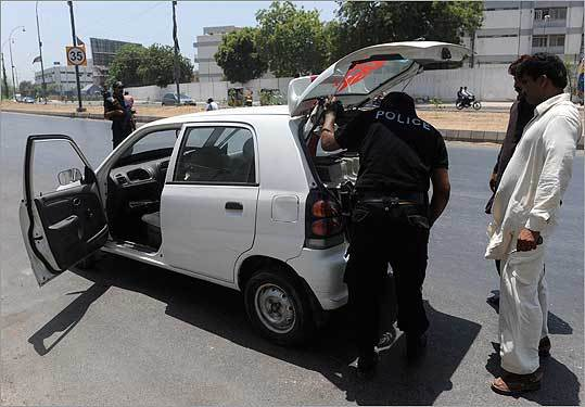 Amid beefed up security, a Pakistani police commando searched a car near the US consulate in Karachi today after the death of bin Laden.