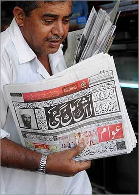 On a street in Karachi, a Pakistani hawker carried evening newspapers with headlines of bin Laden's death.