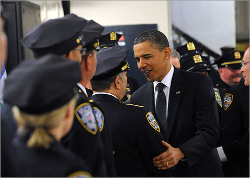 Before laying the wreath, the president met with police officers at the First Precinct police station in lower Manhattan.