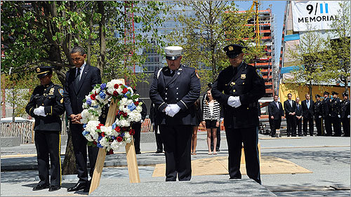The president and participants bowed their heads after laying a wreath at the 9/11 Memorial.