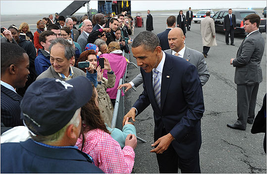 Obama greeted the crowd at Logan Airport Wednesday before heading to two fund-raising events that were expected to raise more than $2 million.