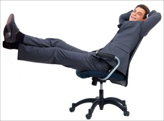 Kick your feet up Sit back in your chair with back supported and feet flat on floor or supported by a foot rest.