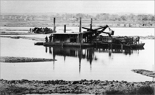 An 1882 photo of dredging in the Back Bay Fens.