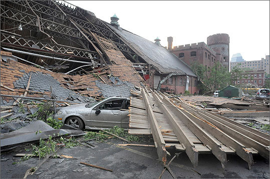 A smashed car was covered in debris at the South End Community Center, which lost most of its roof in a tornado that touched down in Springfield.
