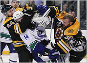 Bruins goalie Tim Thomas battles in front of the net