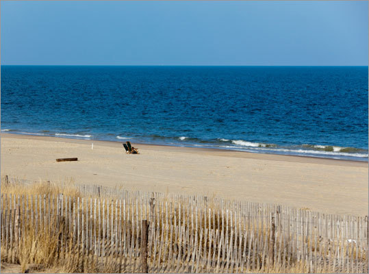 Delaware Dewey Beach , in Sussex County This mile-long beach is surrounded by the Atlantic Ocean and Rehoboth Bay.