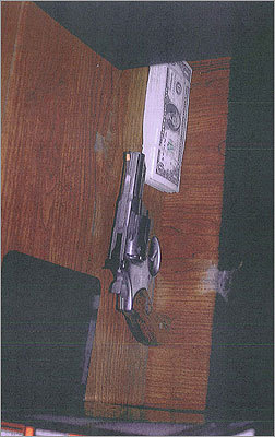 Another handgun, and a stack of money, that the government said was seized from Bulger.