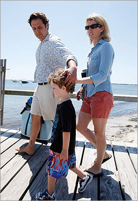 Rory Kennedy, right, her husband Mark Bailey, and an unidentified boy walked along a pier.