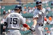 Jacoby Ellsbury is congratulated for his home run by Dustin Pedroia