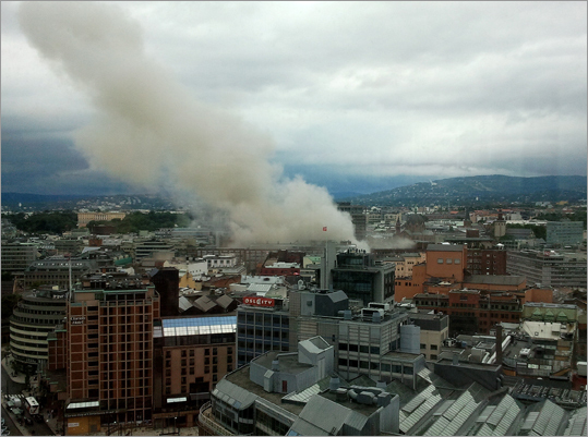 Terrorism ravaged long-peaceful Norway on Friday when a bomb ripped open buildings, including the prime minister's office and a man dressed as a police officer opened fire at a nearby island youth camp. At left, smoke rose from the central area of Oslo on Friday after the explosion.