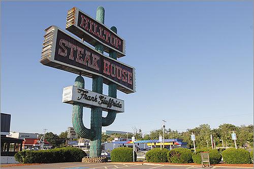 Hilltop Steak House sign.