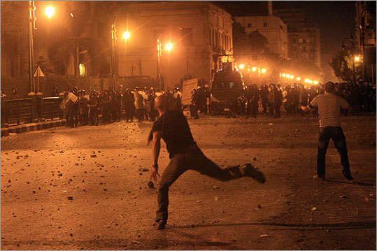 Egyptian protesters threw stones at riot police during violent clashes in Tahrir Square in Cairo in the early hours of June 29, 2011.