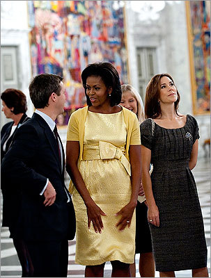 During a visit to the Christiansborg Palace in Copenhagen on Oct. 2, 2009, Mrs. Obama wore a cheerful yellow dress by Michael Kors as she and Danish Crown Prince Frederik (left) and Princess Mary looked at tapestries.