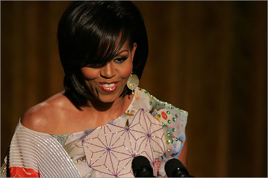 The president's wife wore a colorful Basso & Brooke off-shoulder beaded top during 'An Evening of Poetry, Music and the Spoken Word' in the East Room of the White House on May 12, 2009. President and Mrs. Obama spoke before the evening festivities to celebrate art and culture.