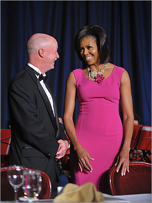 Mrs. Obama wore a hot pink body-hugging Michael Kors dress and a sparkly, bold St. Eramus necklace to the White House Correspondents' Association annual dinner on May 9, 2009, at the Washington Hilton hotel in Washington. Picture, the president's wife chatted with photographer Doug Mills of The New York Times during the event.