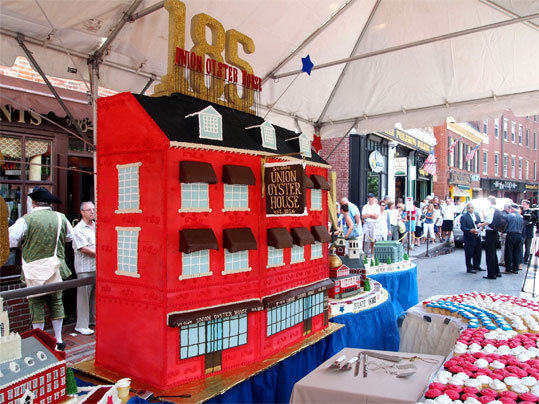 The Union Oyster House celebrated its 185th anniversary on Wednesday, August 3 with an enormous cake depicting the historic restaurant along with several other sites along the Freedom Trail. While the replica of the restaurant itself is made of craft foam covered in icing, all the other buildings are actual cake, except for the occasional steeple or dome, and are edible.