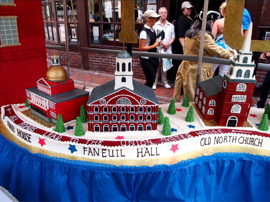 The cake's other side showed the State House, Faneuil Hall, and the Old North Church.