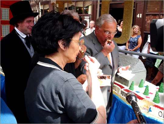 """Menino helped the Milanos cut the cake and then sampled a piece from the grounds of Old City Hall. He said the restaurant was """"not just a tourist place"""" but one where locals could also enjoy great seafood. He thanked the Milanos for their service to the community."""