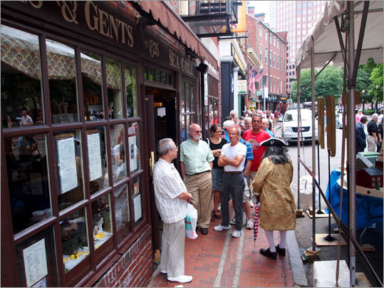 Hungry customers lined Union Street awaiting a chance to have lunch at the anniversary special price of $1.85 a plate.