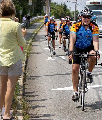 Pan-Mass cyclists rode on Main Street in Buzzards Bay on Saturday, en route to their halfway point during the two day challenge.