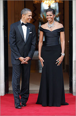 President and Mrs. Obama looked like royalty in their regal black tie attire as they waited to welcome Britain's Queen Elizabeth II and Prince Philip for a reciprocal dinner at Winfield House in London on May 25, 2011. Mrs. Obama was on the latest Vanity Fair International Best Dressed List. A four-year veteran of the list, she was named for the first time as part of a best-dressed couple, although President Obama had been named on his own on the list once in 2009.