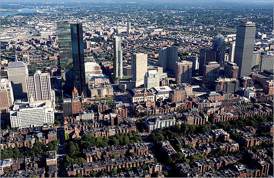 The $500 million project, situated across from the Massachusetts Bay Transportation Authority's Back Bay Station, would fill out the last undeveloped parcels in Copley Place, which was initially built in the 1980s over the Massachusetts Turnpike roadway and ramps, and on a former railroad yard. Shown : An artist's rendering of the city of Boston with the new Copley Place building.