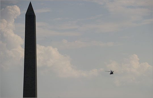 Marine One flew past the Washington Monument after departing from the South Lawn of the White House.