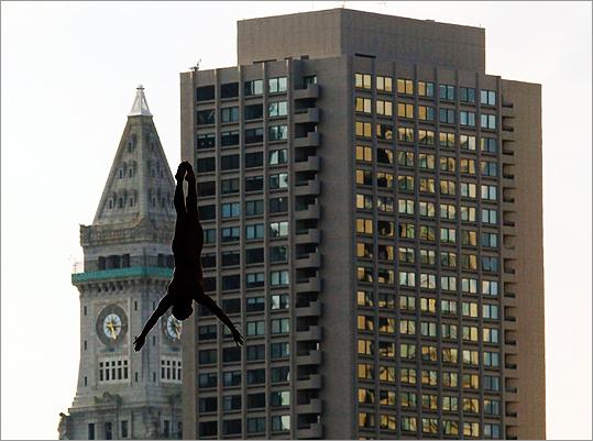Boston's skyscrapers provide the backdrop for Jorge Ferzuli of Mexico's dive.