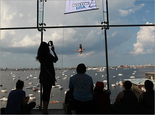 Spectators watch a diver from inside the ICA.