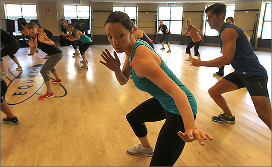 More people want to achieve the buff physique they see on the big screen. Christopher Muther reports on a new class being offered at Equinox gym for people who want to obtain a 'superhero' body -- and fight fat more than crime. Read the story Pictured, Rachel Poor (center) attending the class at Equinox.
