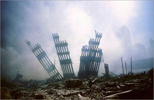 The remains of the World Trade Center stood amid the debris following the terrorist attacks in this Sept. 11, 2001, file photo. Sept. 11 memorial museum planners have proposed displaying pieces of steel recovered from ground zero.