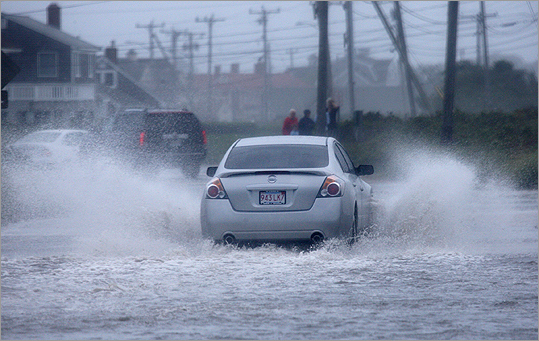 A car navigated Surf Drive during the storm on Sunday.