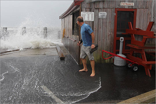 Tony Green peeked around The Clam Shack in Falmouth Harbor on Sunday.