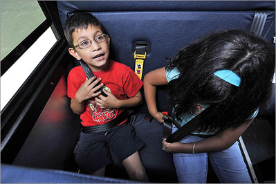 Kids buckle up on school buses