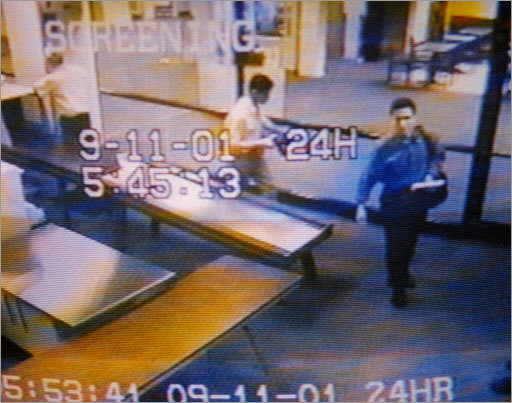 Two men, identified as suspected hijackers Mohamed Atta, right, and Abdulaziz Alomari, center, passed through airport security on Sept. 11, 2001, at Portland International Jetport in this photo from an airport surveillance tape. Authorities say the two men took a commuter flight to Boston before boarding and hijacking American Airlines Flight 11, which was flown into the World Trade Center. Authorities compiled a list of the 19 men they believe hijacked the four planes involved in the disasters of Sept. 11.