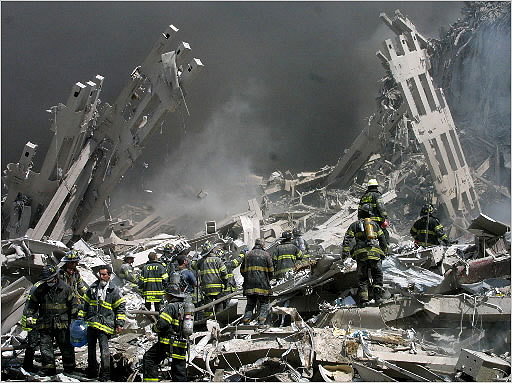 Firefighters made their way through the rubble of ground zero.