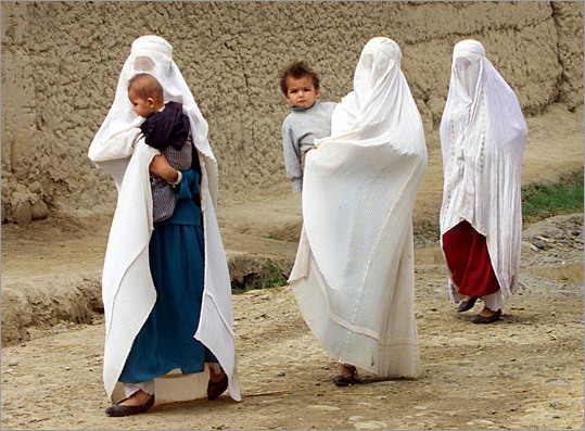 Women pass through an anti-Taliban stronghold in northern Afghanistan.