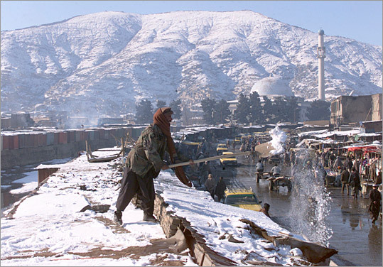 In Kabul, which was dusted by snow yesterday, there are new fears about whether the interim government can handle the factional violence flaring elsewhere in the country.