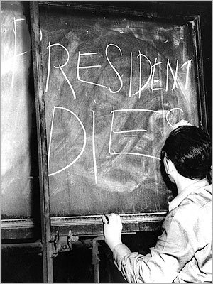 April 14, 1945 Globe staff member updated a storefront blackboard with the news of President Roosevelt's death.