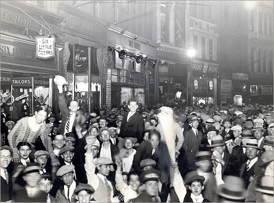 Sept. 23, 1926 Crowd on Newspaper Row listened to a radio broadcast of world's heavyweight title fight between defending champion Jack Dempsey and challenger Gene Tunney in Philadelphia.