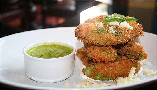 Avocado fries Bristol Lounge The fries: Crispy avocado fries with shaved jalapeno, aged cheddar, and a cilantro dipping sauce My take: Although I'd probably choose a raw avocado over most food, these 'fries,' which Executive Chef Brooke Vosika spent years trying to perfect, are a fun, crispy alternative. Be warned, the cilantro dipping sauce packs a tangy, minty punch. $15 on the bar menu, Bristol Lounge 200 Boylston St., Boston, 617-338-4400.