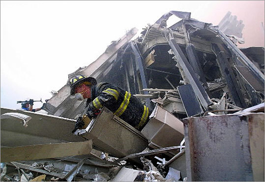 Firefighters made their way through the rubble of the World Trade Center.