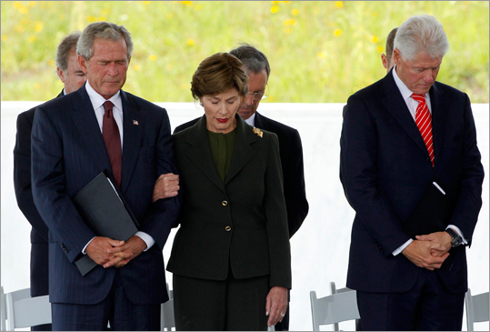 Former U.S. presidents George W. Bush and Bill Clinton and former first lady Laura Bush bowed their heads during the ceremony.