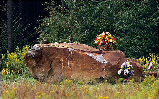 Flowers and small stones on a 17-ton boulder which mark the site of the crash of United Flight 93 in Shanksville.