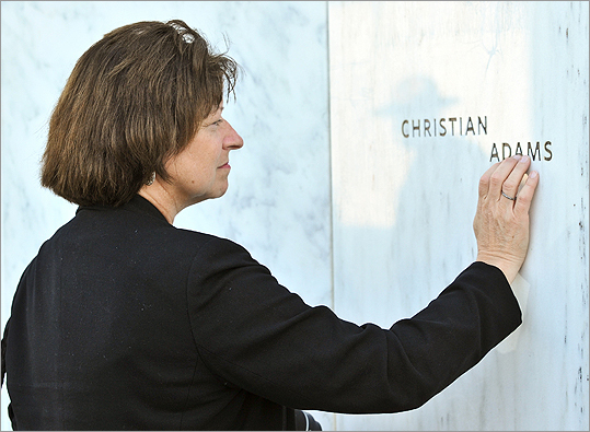 Sheryl Hettman, associate professor at California University of Pennsylvania, touched the name of German victim Christian Adams on the Wall of Names at the newly dedicated Flight 93 memorial.