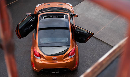 2012 Hyundai Veloster Price: $18,060 On one side, the Veloster is a two-door. Flip it around, and it's suddenly a  four-door. But look again: there are three doors, each with its own unique shape. The B-pillars don't line up, the hatch is raked at an extreme angle, and the exhaust is menacing. If you'd like to drive a concept car that gets 40 miles per gallon on the highway, this is it.