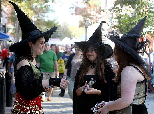 Dressed as witches Laura DiRoberts, Sabrina Small, and Heather Larivee stopped for a chat.