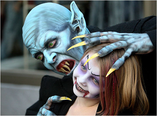 Sydney Carnell, 7, of Monticello, N.Y., posed for a photo with 'Kurt Barlow' during Haunted Happenings on the Essex Street Pedestrian Mall in Salem on Saturday. 2011.